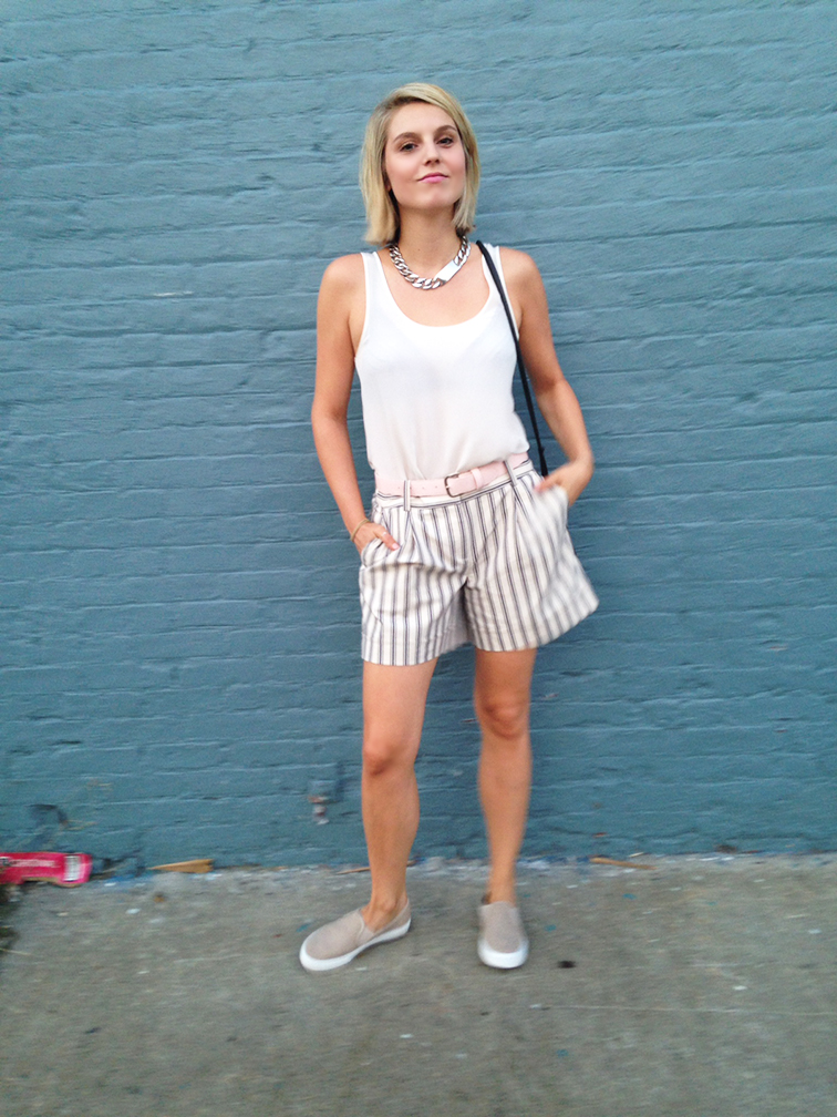H&m white silk tank, Ann Taylor striped bermuda shorts, nude pink Gap slip-on sneakers, blue brick wall in Brooklyn