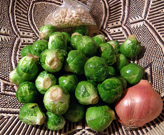 Fresh Brussels Sprouts, Shallot, and Pine Nuts in Basket