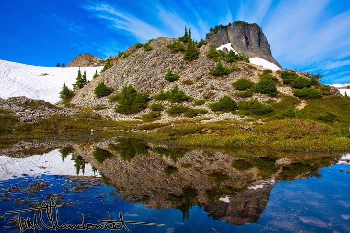 Chimney Rock reflects in a snow melt pond at Artist Point on a sunny summer day in the North Cascades National Park, Tim Chandonnet Photography, Tim C Photo, www.timcphoto.com