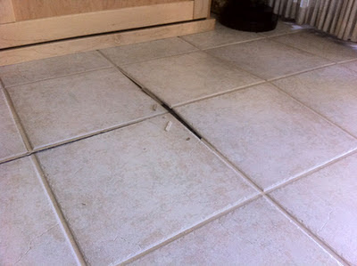 Tenting in tile floor