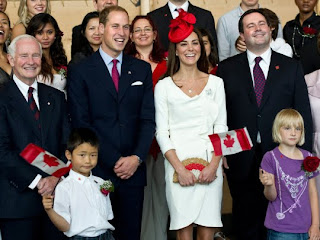 William and Kate, the Duke and Duchess of Cambridge, flanked by Governor General David Johnston, left, and Immigration Minister Jason Kenney smile during a group photo with newly sworn-in Canadians at a citizenship ceremony Friday, July 1, 2011 in Gatineau, Canada.