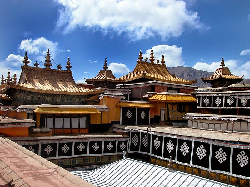 The golden roof group is a unique view of the Potala Palace. It's on the top of the Red Palace, composed of seven roofs made of gilded bronze. They are the tops of the holy stupas of the Dalai Lamas. Every golden roof is decorated with one to five flower-and-bell-shaped spires, which serve as lightning conductors. If you step out on the palace roof, you can see the blue sky and white cloud above your head and overlook the city.
