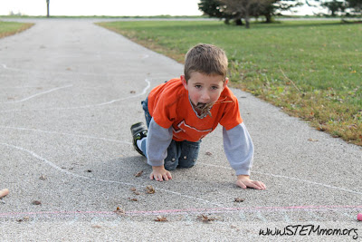 Worm Game: Boy with leaves in his mouth: STEMmom.org