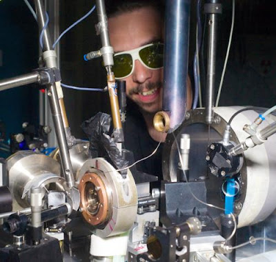 This image shows the experimental set-up of the experiment at ESRF beamline ID27 where the diffraction maps were recorded. The diamond anvil cell is inside the brass cylinder in the center. The image pictures Guillaume Morard, one of the co-authors of the publication, wearing laser safety goggles. Credit: ESRF/Blascha Faust