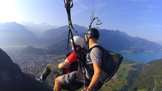 Paragliding 4000ft over the immense Swiss Alps in the home of adventure: Interlaken, Paragliding in Switzerland, How much does it cost to Paraglide, Is Paragliding safe, paraglide in Interlaken, adventure holiday, best place for adventure trip, geneve, Bern, The Alps, Alpine, skydive, fly, freedom, extreme sports, mountain, hike,