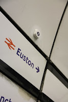Bluetooth beacon affixed to a wall at the Euston station
