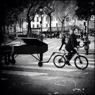 http://www.rollingstone.com/music/news/watch-pianist-perform-john-lennons-imagine-outside-paris-bataclan-20151114