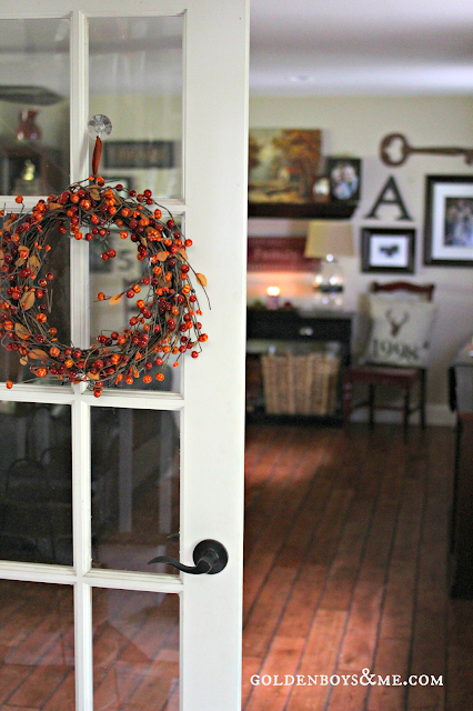 Fall wreath on french doors with gallery wall, part of Fall Home Tour via www.goldenboysandme.com