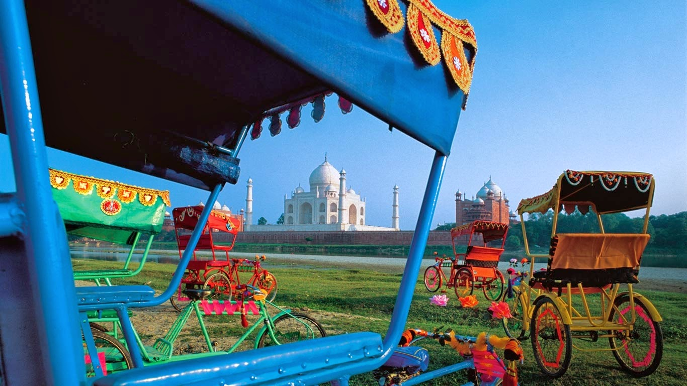 Rickshaws and view of Taj Mahal, Agra, India (© Dinesh Khanna/Axiom) 287