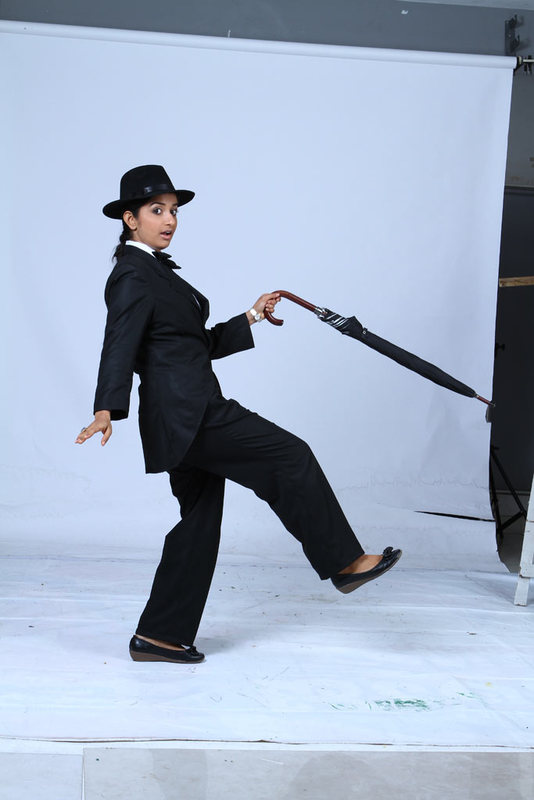 Meera Jasmine latest Photoshoot as Charlie Chaplin for Anbulla Kamal movie sexy stills