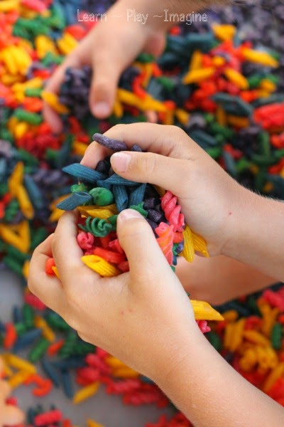 Rainbow pasta sensory play - hands down the best and easiest method for dyeing pasta