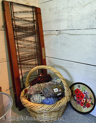 Yarn basket and old loom heddles leaning in the corner