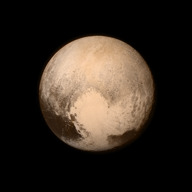 "Pluto nearly fills the frame in this image from the Long Range Reconnaissance Imager (LORRI) aboard NASA's New Horizons spacecraft, taken on July 13, 2015, when the spacecraft was 476,000 miles (768,000 kilometers) from the surface. This is the last and most detailed image sent to Earth before the spacecraft's closest approach to Pluto on July 14. The color image has been combined with lower-resolution color information from the Ralph instrument that was acquired earlier on July 13.   This view is dominated by the large, bright feature informally named the ""heart,"" which measures approximately 1,000 miles (1,600 kilometers) across. The heart borders darker equatorial terrains, and the mottled terrain to its east (right) is complex. However, even at this resolution, much of the heart's interior appears remarkably featureless—possibly a sign of ongoing geologic processes.   Credit: NASA/Johns Hopkins University Applied Physics Laboratory/Southwest Research Institute"