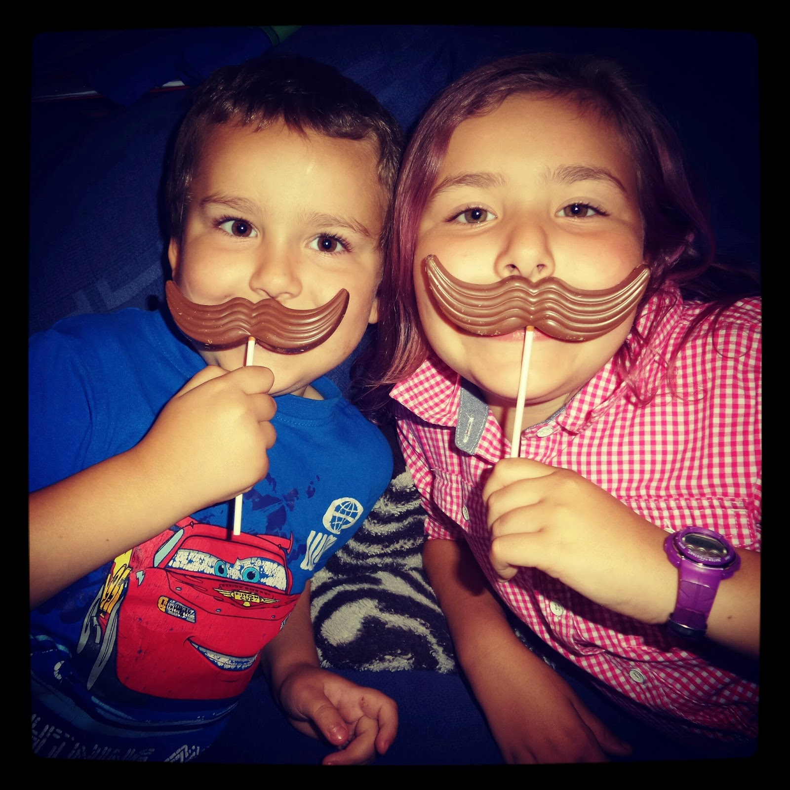 My brother and I being daft with moustache lollys