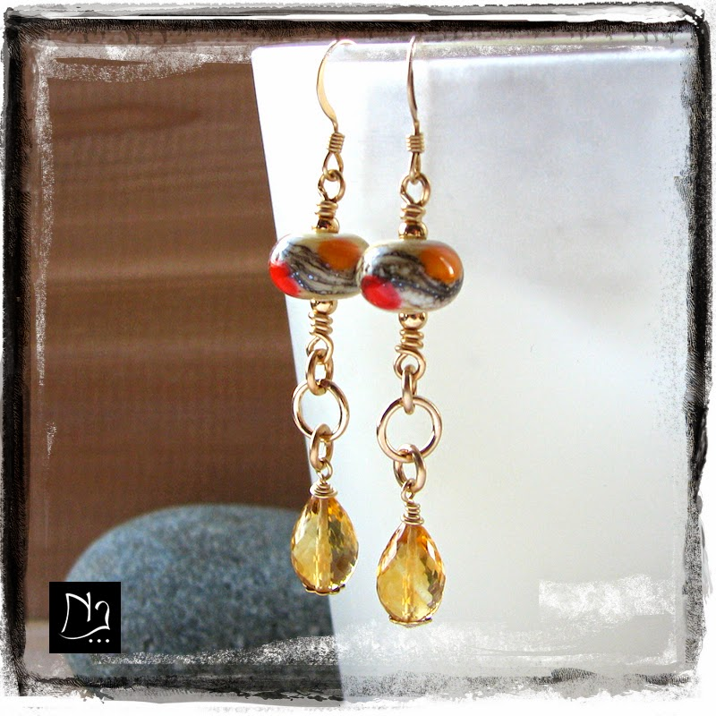 http://www.nathalielesagejewelry.com/products/yellow-earrings