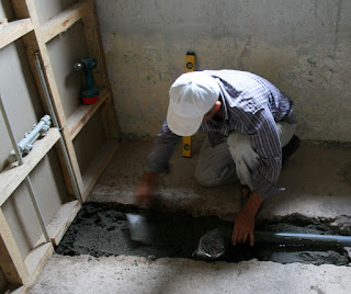 Fitting the wet room drain in the correct place