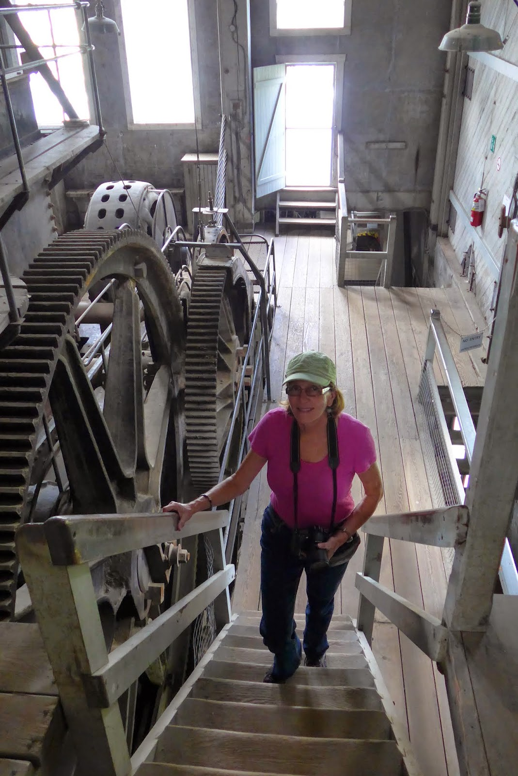 Liz walking up the stairs inside the dredge.