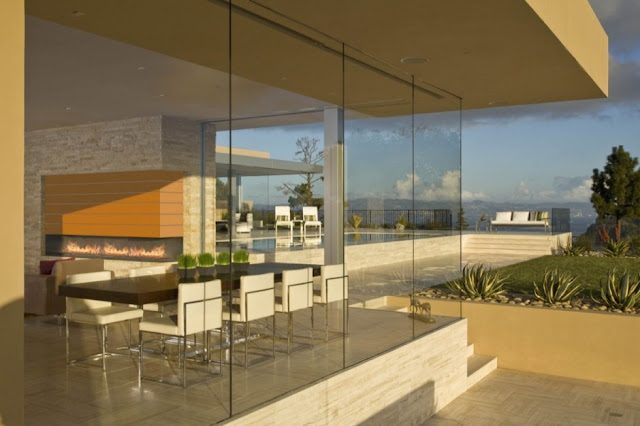 Photo of dinning room as seen from the outside through glass wall