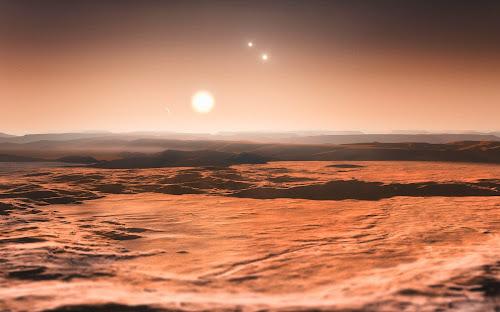 Vista do exoplaneta Gliese 667Cd em direção à sua estrela progenitora (Gliese 667C), com as estrelas mais distantes deste sistema triplo (Gliese 667A e Gliese 667B) ao fundo.