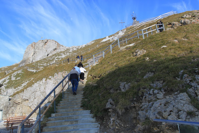 walking up on the steps in order to see the overview of Pilatus Kulm (Mount Pilatus) in Lucerne, Switzerland