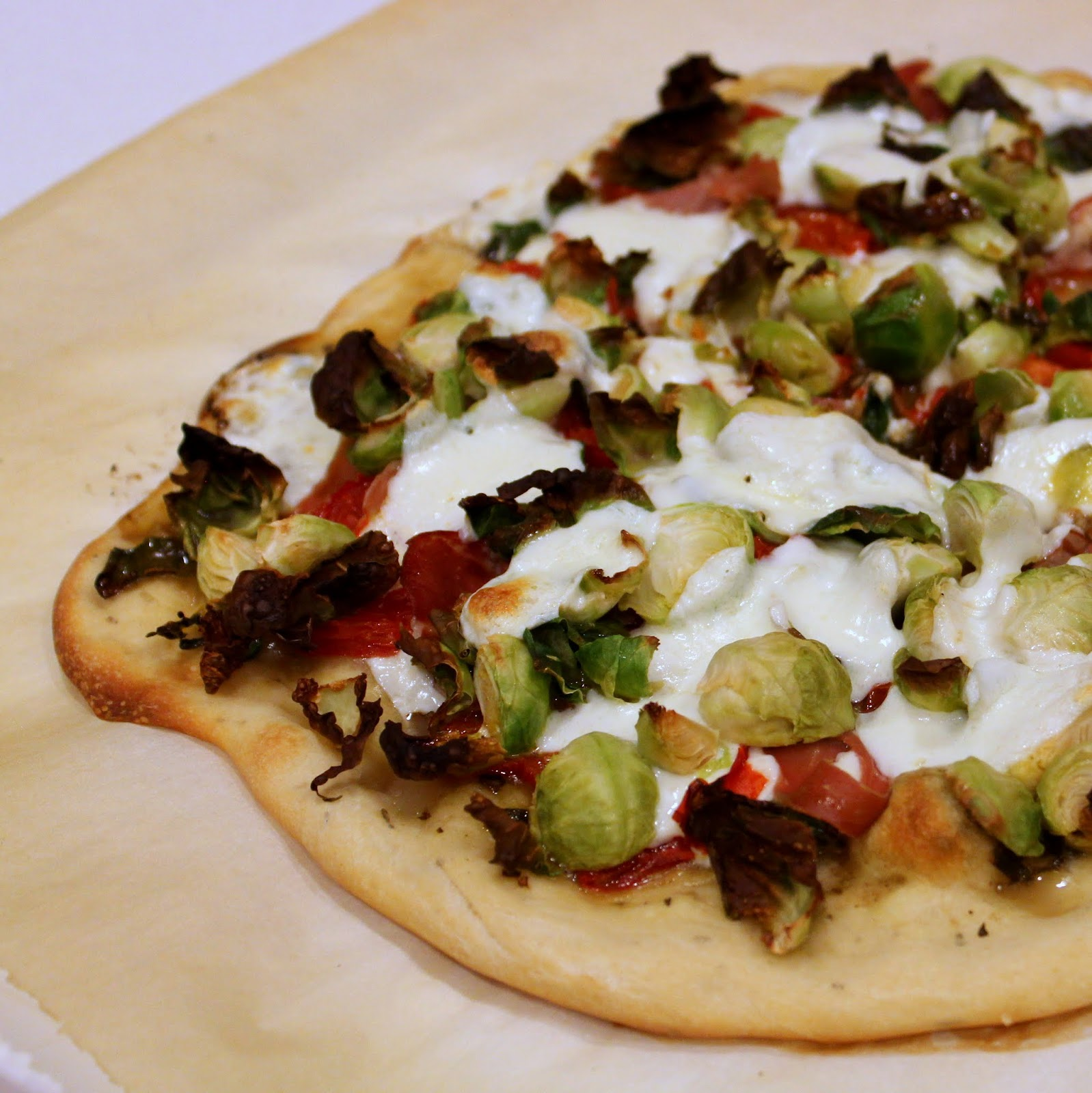 Flatbread pizza with brussel sprouts, prosciutto, and mozzarella