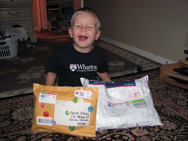 Derek got a package from both grandparents on the same day. He was so happy.