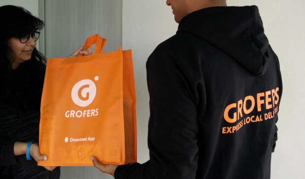 Grofers Delivery pics orange bag