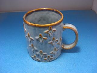 http://bargaincart.ecrater.com/p/23457171/starbucks-2008-mug-rasied-relief-brown#