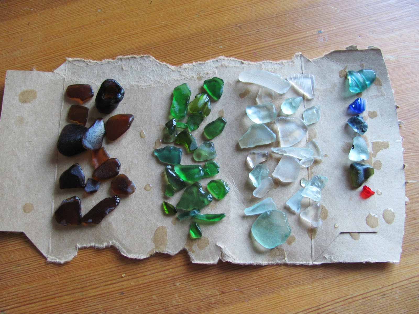Brown, Green, White, and a small variety of other colors of sea glass on display in Dublin, Ireland