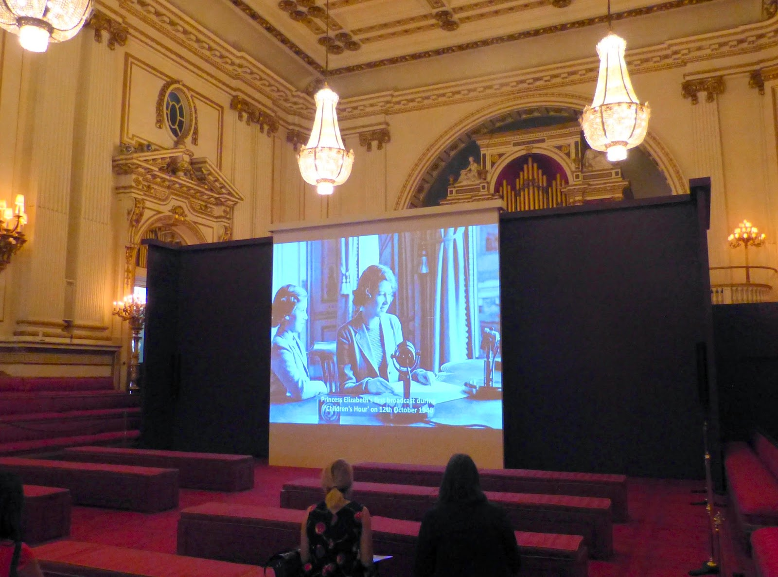 Footage about the Queen as a child being shown in The Ballroom
