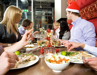 Group having a holiday dinner party at restaurant