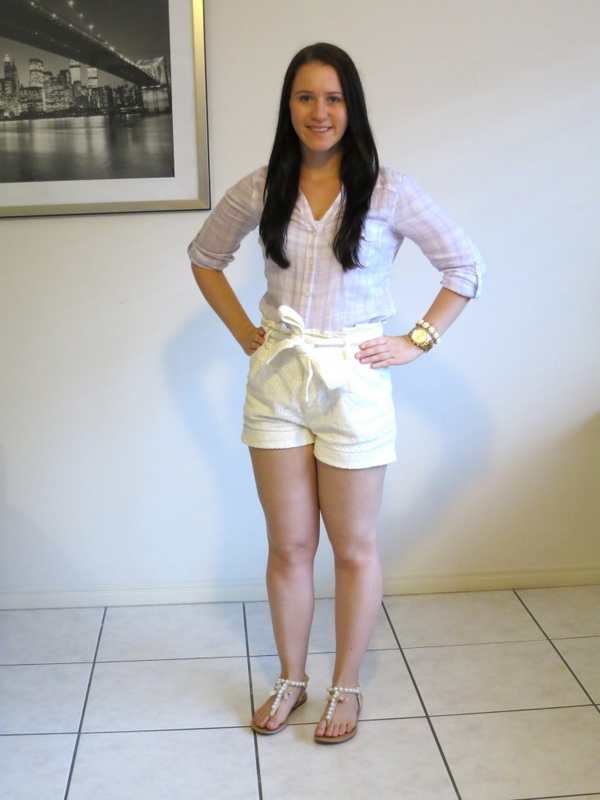 Cream lace shorts, purple plaid shirt and gold accessories.