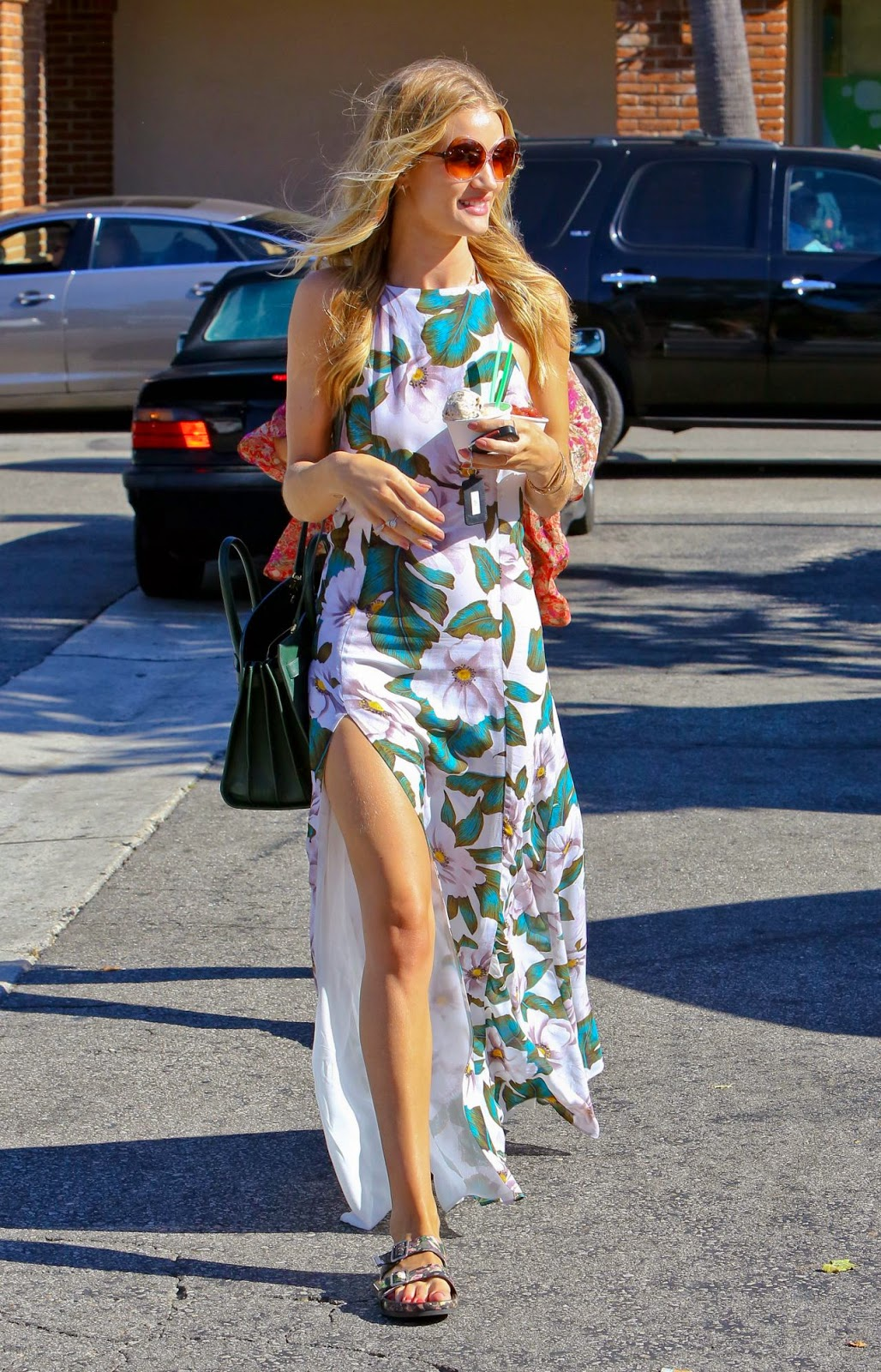 Rosie Huntington-Whiteley pairs floral maxi dress with Givenchy sandals for Malibu outing