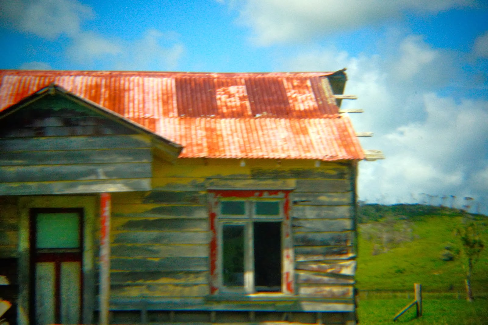 Another view of the same abandoned house in Northland, New Zealand. The roof is rusting off.