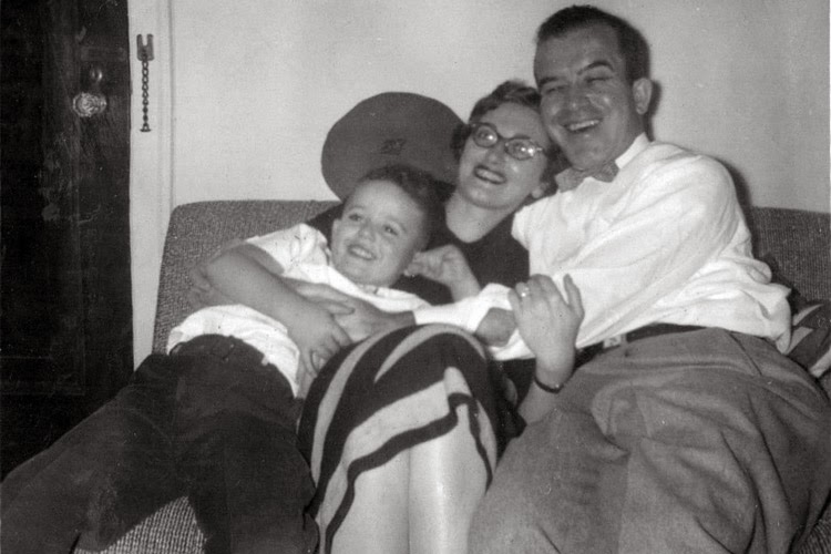 David Ocker age 4 with Marion and Ben Shuman reclining on a couch - Thanksgiving 1955