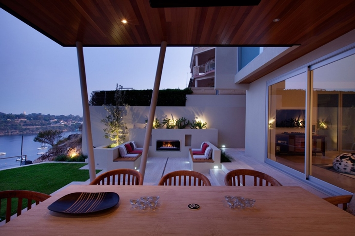 Wooden table in Modern backyard by Ritz Exterior Design