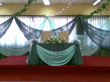 A Bridal Gazebo Decorated With Pink And Mint Green