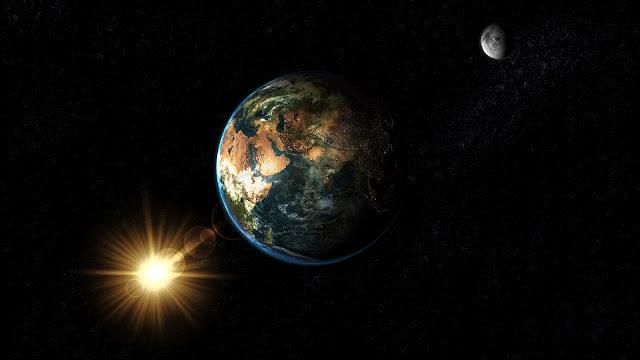 De ruimte met aarde, zon en maan