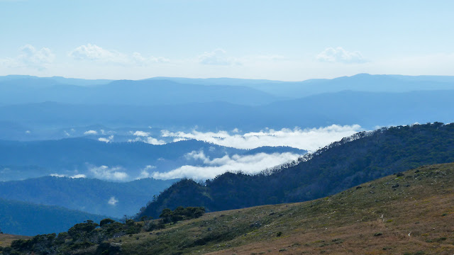 clouds in valley below mount howitt