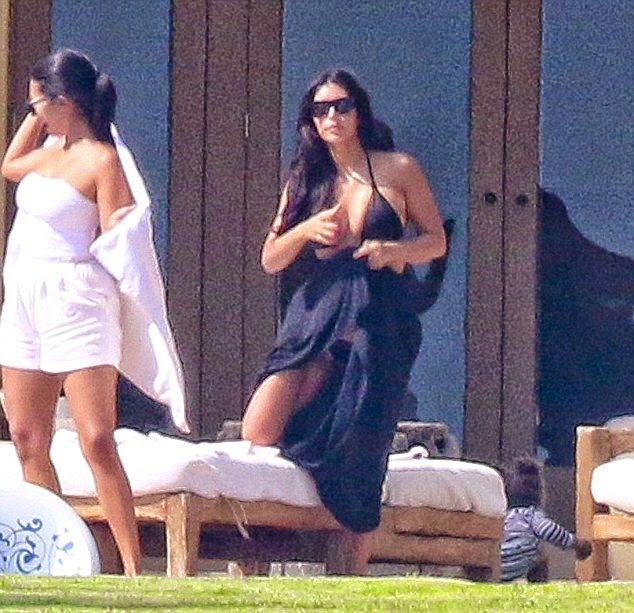 Kim Kardashian has been extensive to chasing the sun since Monday, squeezing in trips to Puerto Vallarta, Mexico on Thursday, July 17, 2014.