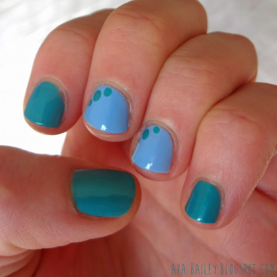 Turquoise nails with light blue accent nails, easy dots
