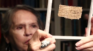 Karen King with the papyrus fragment