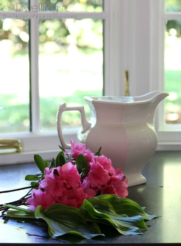 centerpiece with azaleas, hosta and ironstone