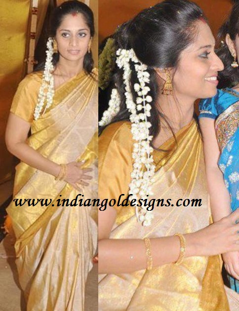 Latest saree designs shalini in gold kanchipuram silk saree checkout shalini in gold kanchipuram silk saree paired with matching short sleeves blouse altavistaventures Images