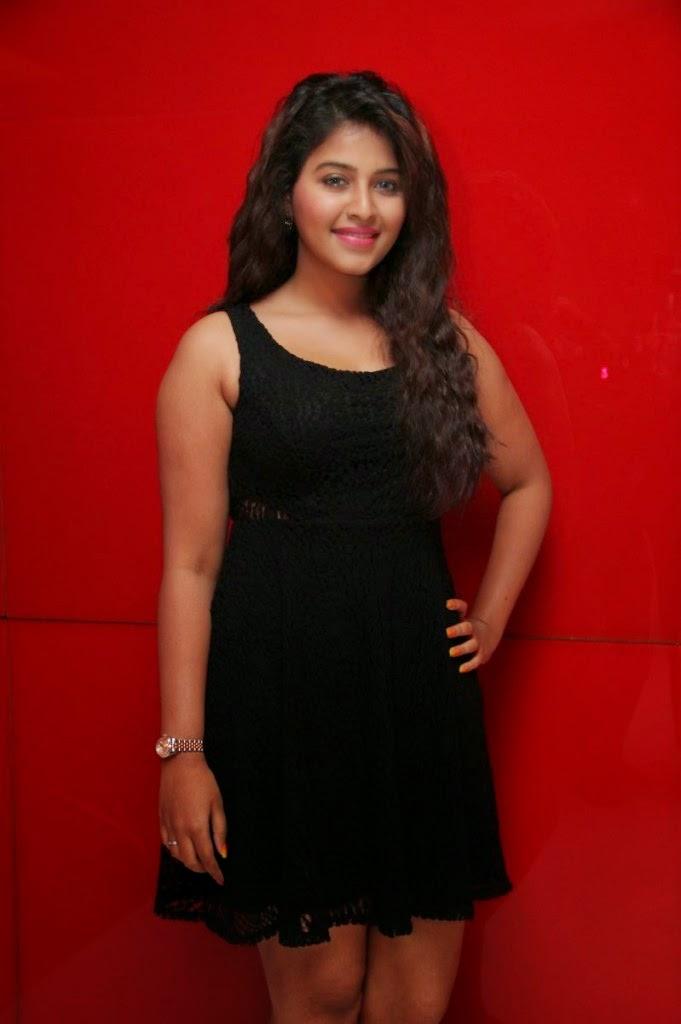 anjali hot legs in black mini skirt
