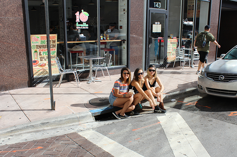 Friends on the curb in downtown Miami