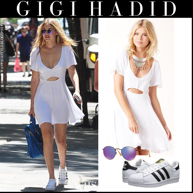 Gigi Hadid in white mini dress with purple round Ray Ban sunglasses and white Adidas Superstar sneakers what she wore july 10