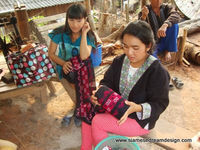 Young Hmong women with their embroidery