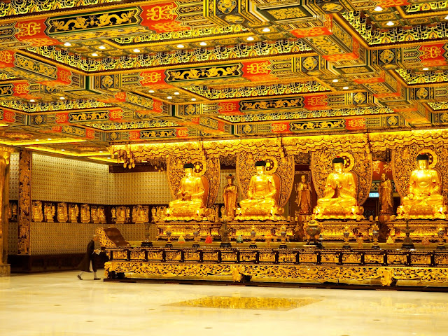 Golden statues and ceiling patterns in the Hall of Ten Thousand Buddhas, Po Lin Monastery, Ngong Ping, Lantau Island, Hong Kong