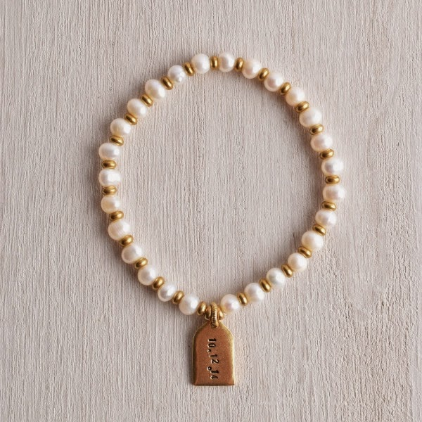 http://www.whitetrufflestudio.com/collections/bracelets/products/white-truffle-personalized-tag-pearl-bracelet